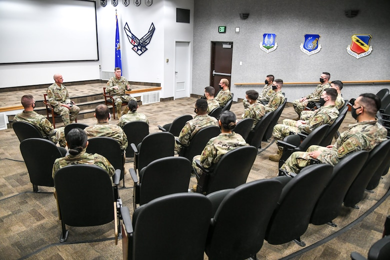 Airmen during Airman Leadership School seated and socially distanced in an auditorium.