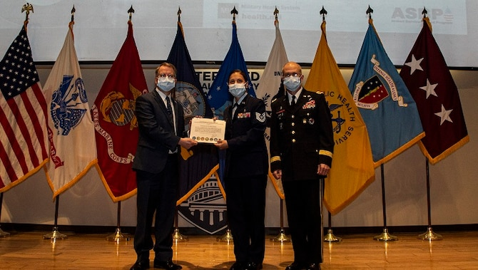 Image of Deputy Secretary of Defense David L. Norquist, left, and U.S. Army Lt. Gen. Ronald J. Place, right, and U.S. Air Force Tech. Sgt. Christina Swope