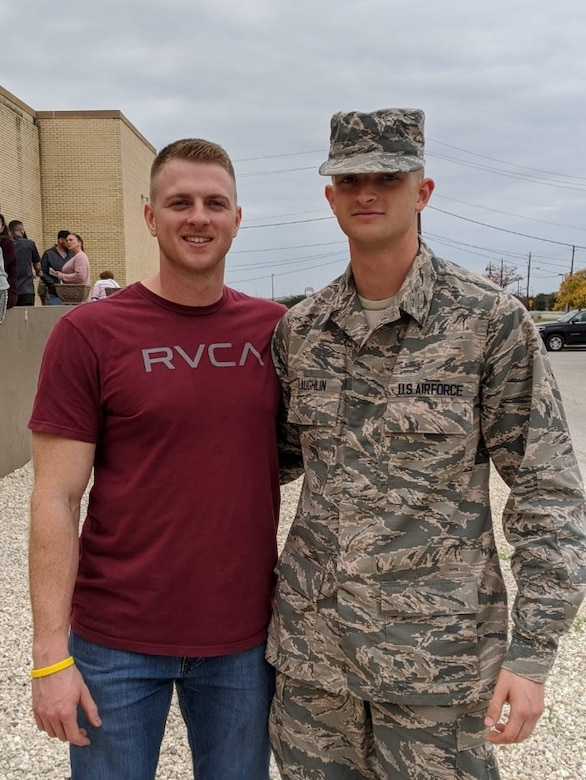 Airman 1st Class Justin Laughlin, right, poses with his brother Staff Sgt. Cody Laughlin.