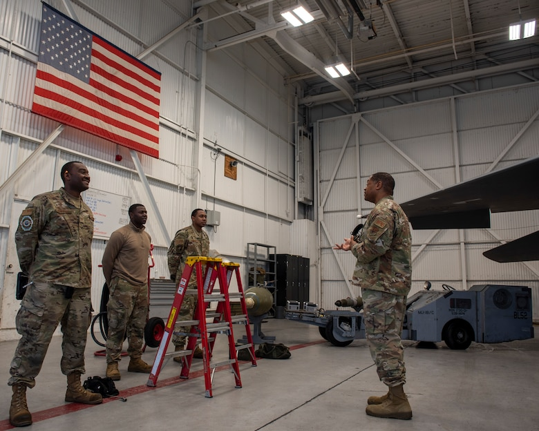 Tech Sgt. Jevon Charles, 4th Fighter Readiness Squadron weapons academic instructor (right), briefs a 3-man crew on loading a Bomb Rack Unit onto an F-15E Strike Eagle at Seymour Johnson Air Force Base, North Carolina, Nov. 12, 2020.