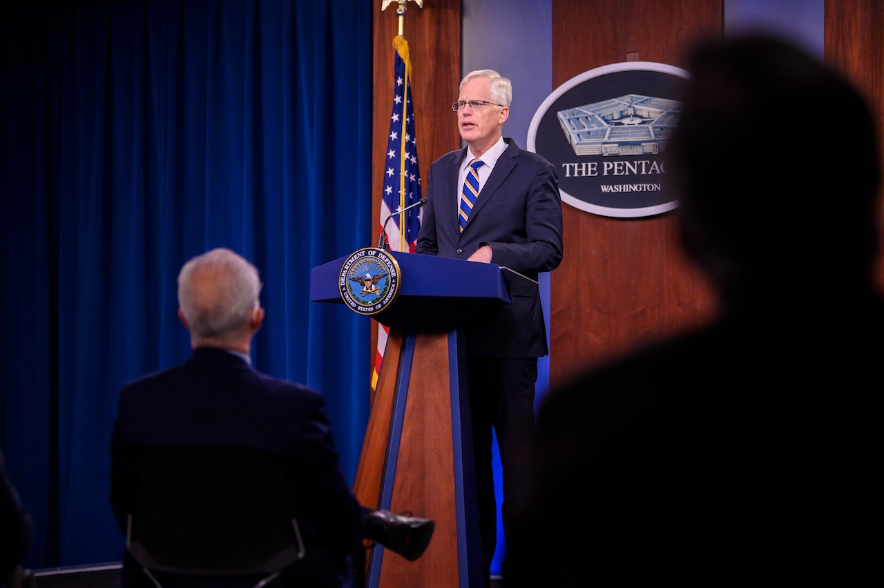 Acting Defense Secretary Christopher C. Miller speaks at a podium.
