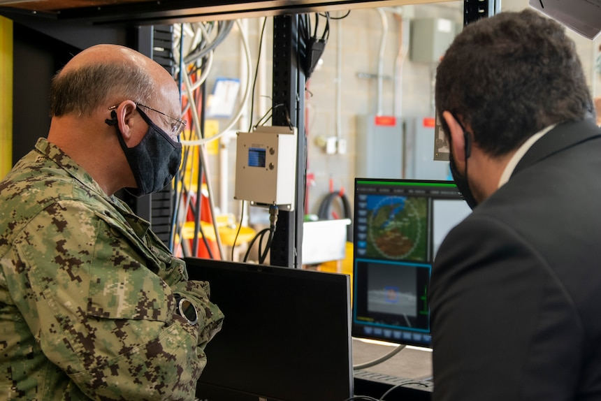 (Nov. 17, 2020) - Chief of Naval Operations (CNO) Adm. Mike Gilday receives a brief on the Optical Dazzler Interdictor (ODIN) at Naval Surface Warfare Center (NSWC) Dahlgren, Virginia, Nov. 17. CNO traveled to Dahlgren to visit Sailors and civilians and receive briefs on a variety of programs like High Energy Lasers, Solid Laser Technology Maturation (SSL-TM) and Layered Laser Defense (LLD).  (U.S. Navy photo by Lieutenant Rachel Maul/Released)