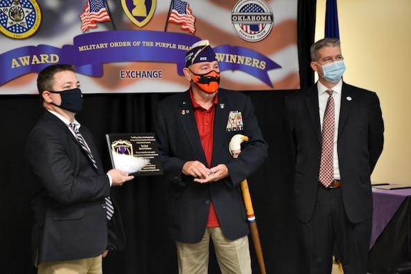 Man receives an award.