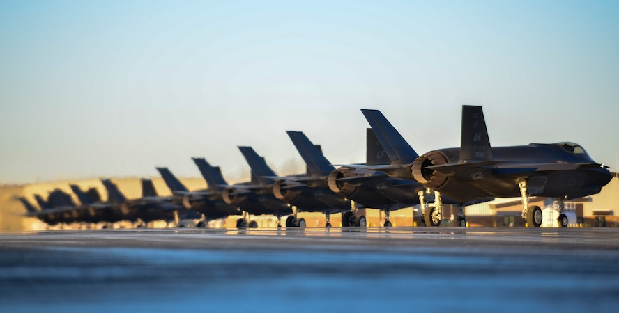Twelve F-35A Lightning IIs assigned to the 356th Fighter Squadron line up on the flightline during Arctic Gold 21-1 at Eielson Air Force Base, Alaska, Nov. 17, 2020.
