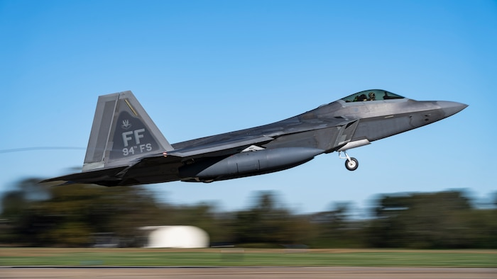 A U.S. Air Force F-22 Raptor aircraft assigned to the 1st Fighter Wing takes flight at Joint Base Langley-Eustis, Virginia, Nov. 4, 2020. A contingent of 94th Fighter Squadron Airmen and F-22 Raptors assigned to the 1st Fighter Wing, deployed to Andersen Air Force Base, Guam, to conduct missions in the Western Pacific with allies and joint partners.