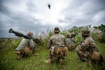 U.S. Marines with 3rd Low Altitude Air Defense Battalion (LAAD) use a Tracking Head Trainer (THT), a training weapon system used by LAAD units to gain proficiency with the stinger missile system without having to utilize live ammunitions, to track the movements of a CH-53E Super Stallion with Marine Heavy Helicopter Squadron 361 (HMH-361) during a combined Ground Threat Reaction (GTR) training event at the northern training area, Okinawa, Japan, Oct. 23, 2020.