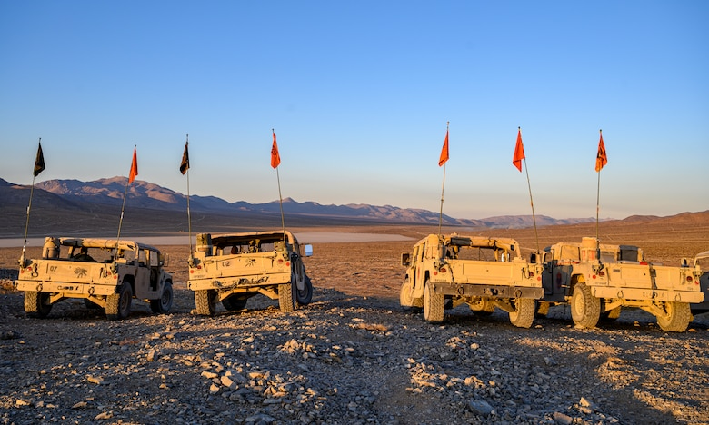 Humvees parked on a hill.