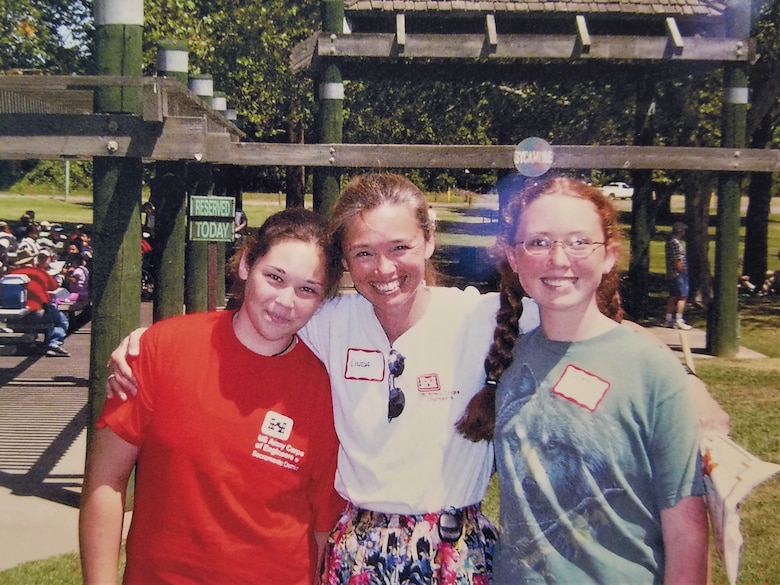 Linda Finley poses with her daughters Morgan, left, and Jackie, right, during the 2004 Sacramento District picnic. Both of Finley's daughters have grown up to become engineers as well.