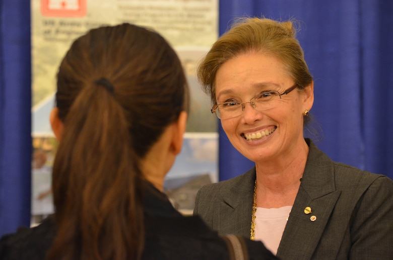 UC Davis alumna Linda Finley speaks with a student during a career fair there in 2012.