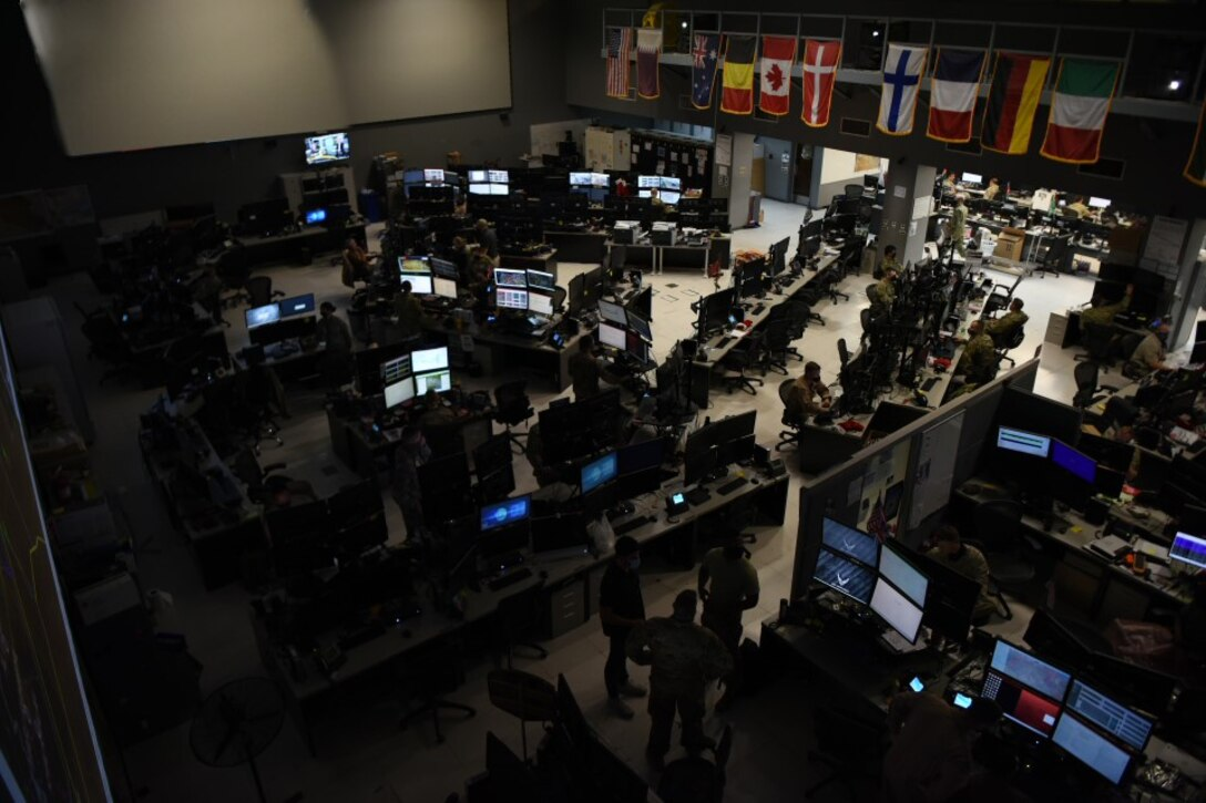 U.S. Air Forces Central Airmen work in the Combined Air Operations Center, Al Udeid Air Base, Qatar. AFCENT's 609th Air Operations Center made history this week when it became the first AOC to operationally utilize the Kessel Run All Domain Operations Suite to plan and execute the Master Air Attack Plan. (U.S. Air Force photo by Staff Sgt. Dustin Mullen)