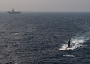The Indian navy submarine INS Khanderi, steams ahead of the aircraft carrier USS Nimitz (CVN 68) and the guided-missile cruiser USS Princeton (CG 59) while participating in Malabar 2020.