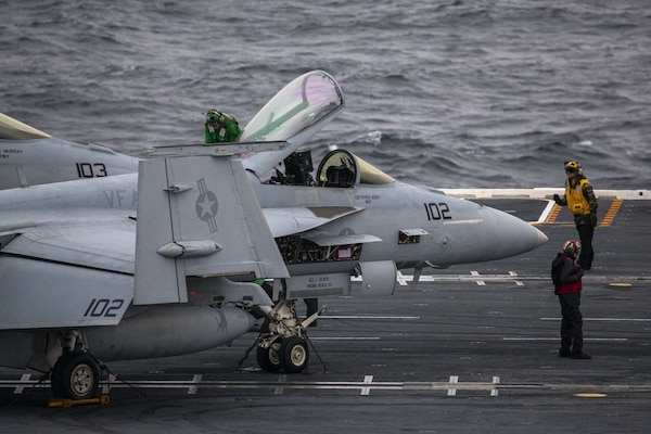"Sailors assigned to the aircraft carrier USS Gerald R. Ford (CVN 78) and the ""Ragin' Bulls""of Strike Fighter Squadron (VFA) 37, perform pre-flight checks on an F/A-18E Super Hornet Nov. 13, 2020."