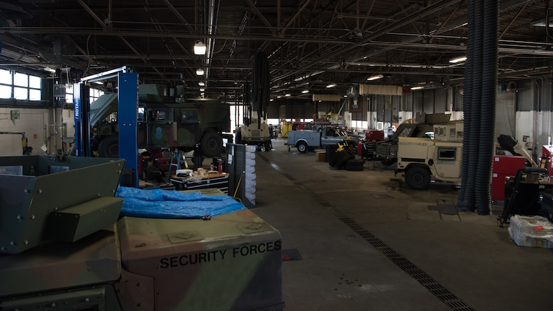 Vehicle maintenance technicians work on a variety of vehicles inside the low bay of vehicle maintenance.