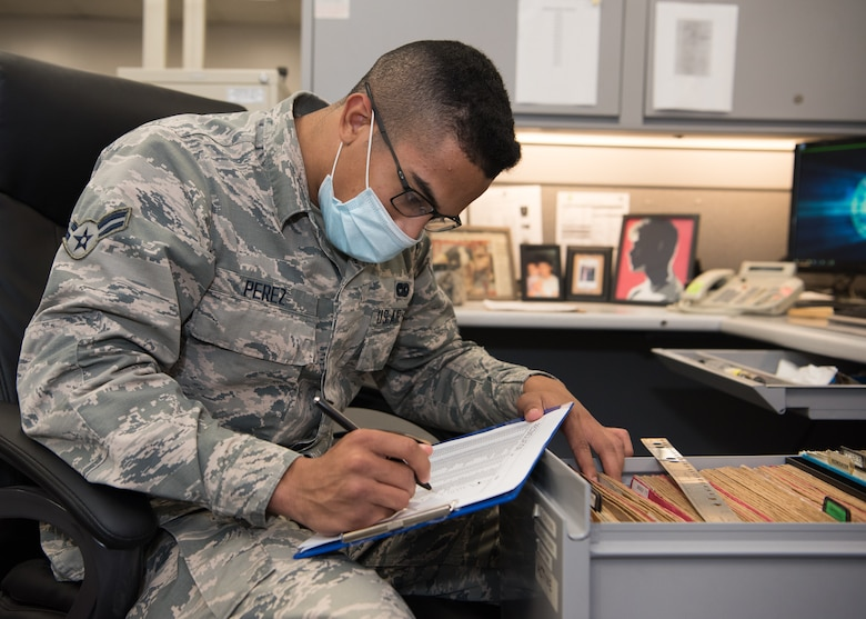 Airman 1st Class Gabriel Perez, 509th Logistics Readiness Squadron fleet management and analysis sorts files while sitting in his office.