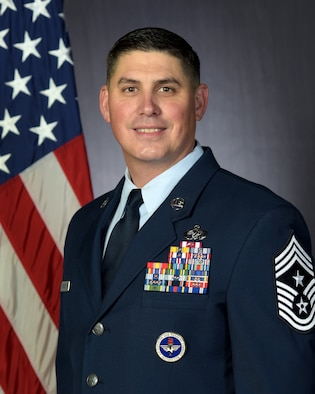 Official photo of CMSgt Jason Delucy