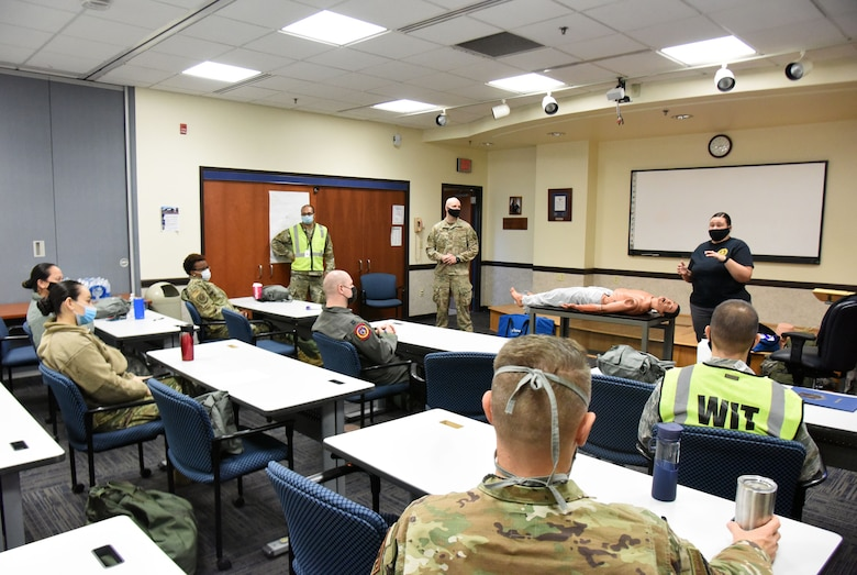 U.S. Air Force Maj. Gyasi Mann, 108th Medical Group public health officer, U.S. Air Force Staff Sgt. Craig Virginia, 421st Combat Training Squadron tactical combat casualty care NCOIC and Barbara Hoyt, 421st CTS contingency skills instructor, teach participants about the fundamentals of TCCC at the 108th MDG training classroom, Nov. 16, 2020, on Joint Base McGuire-Dix-Lakehurst, N.J. The training helps participants provide casualty treatment care during combat operations. (U.S. Air Force photo by Daniel Barney)