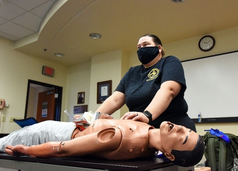Barbara Hoyt, 421st Combat Training Squadron contingency skills instructor, instructs participants about tactical combat casualty care at the 108th Medical Group training classroom, Nov. 16, 2020 on Joint Base McGuire-Dix-Lakehurst, N.J. Hoyt specializes in TCCC to ensure that military personnel provide pre-hospital care to others while in combat zones. (U.S. Air Force photo by Daniel Barney)