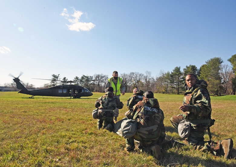 U.S. Air Force Lt. Col. Joshua Swantek, 108th Medical Group wing inspection team leader, prepares participants for their first MEDEVAC tactical combat casualty care mock casualty training at the Babe Ruth Field, Nov. 16, 2020 at Joint Base McGuire-Dix-Lakehurst, N.J. This training helps military personnel on how to transport patients in and out of moving vehicles. (U.S. Air Force photo by Daniel Barney)