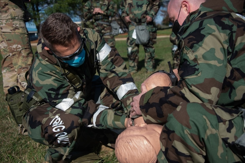Airmen from the 108th Wing set a mock patient on a litter to be transported as part of a Medical Evacuation and Tactical Combat Casualty Care training on Joint Base McGuire-Dix-Lakehurst, N.J., Nov. 16, 2020. The MEDEVAC TCCC training gives a basic understanding of how service members can apply emergency triage in any applicable situation in a deployed environment. (U.S. Air Force photo by Airman 1st Class Joseph Morales)