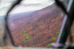A C-130J Super Hercules flies over the mountains in West Virginia.