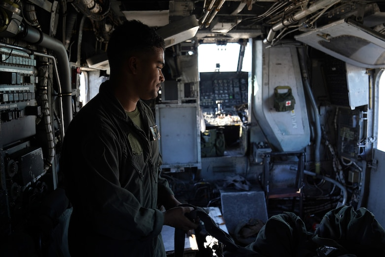 U.S. Marine Corps Cpl. Ramiro Murillo, Marine Heavy Helicopter Squadron 464 air frames mechanic, Marine Corps Air Station New River, North Carolina, inspects equipment inside a Sikorsky CH-53E Super Stallion on the flightline at Keesler Air Force Base, Mississippi, Nov. 17, 2020. Marines came to Keesler to conduct routine training operations in and around the Mississippi area. (U.S. Air Force photo by Airman 1st Class Seth Haddix)
