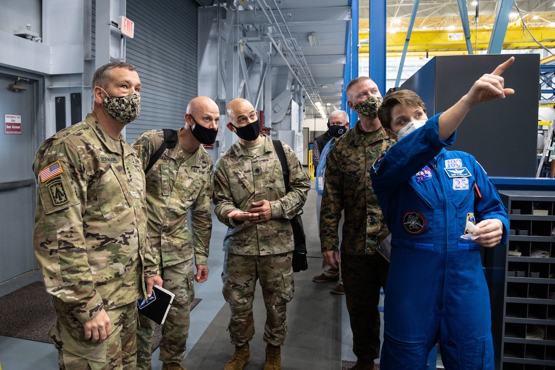 Astronaut gives tour to U.S. Space Command personnel.