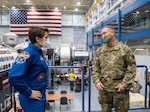General presents astronaut with award.