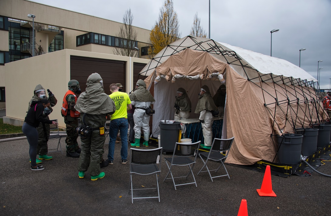 U.S. Air Force Airmen assigned to the 52nd Medical Group assess mock patients during an exercise at an in-place patient decontamination tent at Spangdahlem Air Base, Germany, Nov. 17, 2020. The IPPD is set up to decontaminate patients and to prevent the spread of possible chemical exposure to the medical facility. (U.S. Air Force photo by Senior Airman Chance D. Nardone)