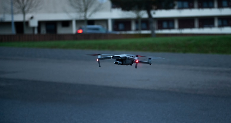 A drone used during a base readiness exercise hovers in mid air at Spangdahlem Air Base, Germany, Nov. 17, 2020. The base readiness exercise periodically used drones to test the capabilities of the drone-capturing technology systems on base. (U.S. Air Force photo by Senior Airman Ali Stewart)