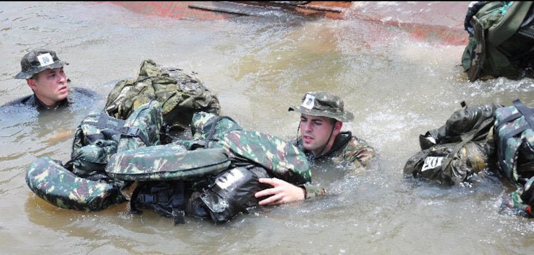 New York Air National Guard Senior Airman Caleb Lapinel trains on tactical swimming in a Brazilian river in October 2020 while attending the  international course conducted annually by the Brazil Jungle Warfare Center, known as CIGS for its Portugese initials. Lapinel was the only American in the class of 10.