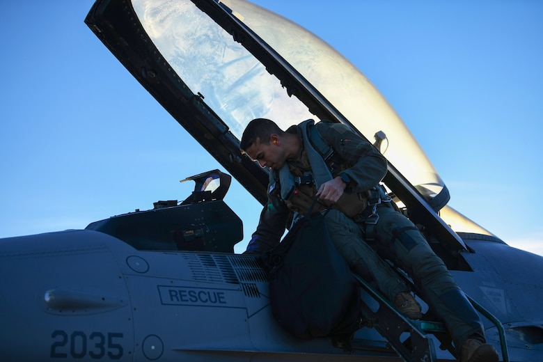 A 555th Fighter Squadron pilot, performs a pre-flight check on a U.S. Air Force F-16 Fighting Falcon during a Bosnia and Herzegovina Air-to-Ground integration bi-lateral exercise.