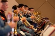 U.S. Marines with the III Marine Expeditionary Force Band and members with the Japan Ground Self-Defense Force 15th Brigade Band perform together during the 25th Annual Combined Concert at Camp Foster, Okinawa, Japan, Nov. 17.