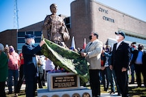 Lorenz Walker, Bossier City mayor and retired U.S. Air Force colonel, and Joey Strickland, Louisiana Department of Veterans Affairs secretary, unveil the Women Veterans of the Ark-La-Tex statue at the Bossier City Civic Center in Bossier City, La., Nov. 11, 2020. The Women Veterans of the Ark-La-Tex statue is dedicated to the women, past and present, who have served in the U.S. military. (U.S. Air Force photo by Airman 1st Class Jacob B. Wrightsman)