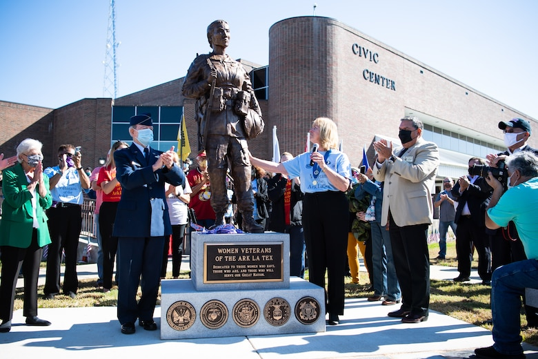 Lorenz Walker, Bossier City mayor and retired U.S. Air Force colonel; Sandy Franks, Women Veterans of the Ark-La-Tex president; and Joey Strickland, Louisiana Department of Veterans Affairs secretary, unveil the Women Veterans of the Ark-La-Tex statue at the Bossier City Civic Center in Bossier City, La., Nov. 11, 2020. The Women Veterans of the Ark-La-Tex statue is dedicated to the women, past and present, who have served in the U.S. military. (U.S. Air Force photo by Airman 1st Class Jacob B. Wrightsman)