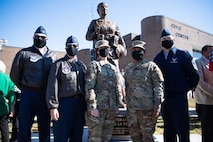 Leaders from Barksdale Air Force Base, La., pose for a photo in front of the newly unveiled Women Veterans of the Ark-La-Tex statue at the Bossier City Civic Center in Bossier City, La., Nov. 11, 2020. The statue was unveiled during a Veteran's Day celebration at the Bossier City Civic Center. (U.S. Air Force photo by Airman 1st Class Jacob B. Wrightsman)
