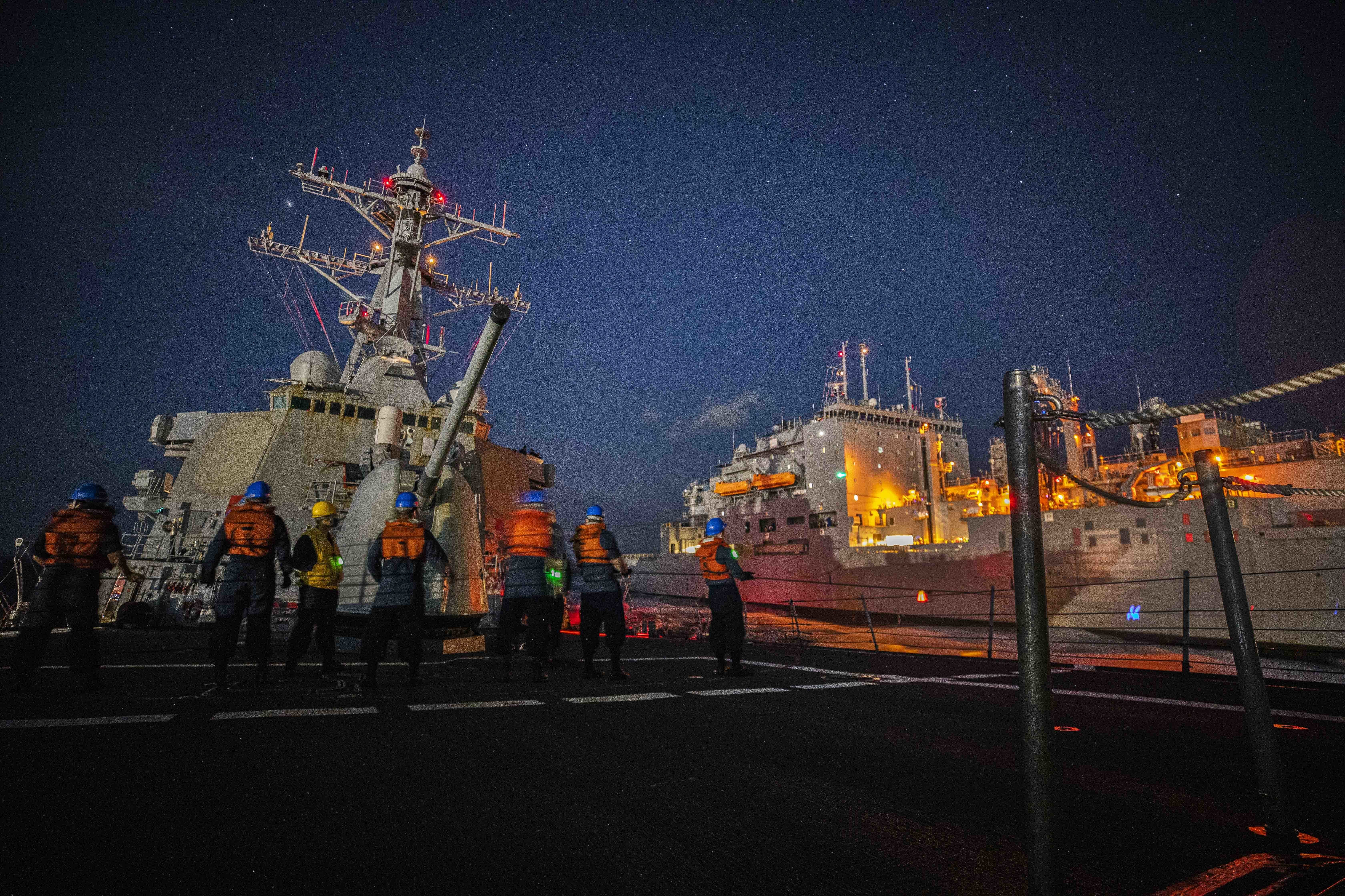 USS John S. McCain (DDG 56) conducts a replenishment-at-sea with USNS Charles Drew (T-AKE 10).