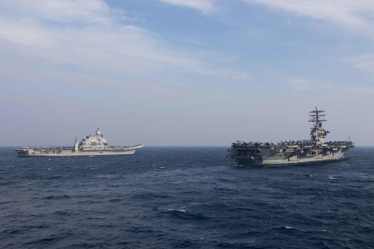 USS Nimitz (CVN 68) steams alongside the Indian navy aircraft carrier INS Vikramaditya (CV-R33) during Malabar in the North Arabian Sea.