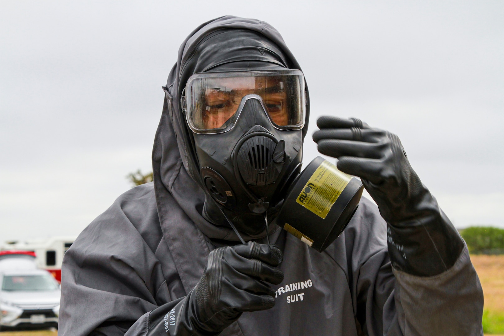 Spc. Isaac Acosta, 68th Engineer Construction Company horizontal engineer, pulls his hazmat suit over his protective mask during the Urban Search and Rescue lane at the San Antonio Fire Academy Nov. 6. This lane is part of a larger exercise run by U.S. Army North's Civil Support Training Activity, a unit comprised of teams that train with state and regional forces on a range of tiered chemical, biological, radiological and nuclear technical tasks that aid in the effective support of civil authorities during a response.