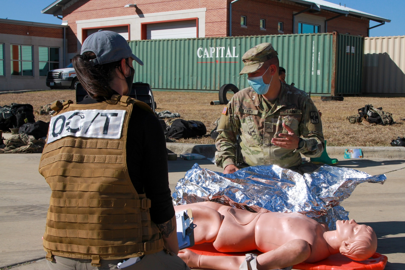 Alexandra Broussard, an Army Interagency Training Education Center observer controller, evaluates Cpl. Robert Lynch, 581st Medical Company Area Support medic, during the Urban Search and Rescue lane at the San Antonio Fire Academy Nov. 5.