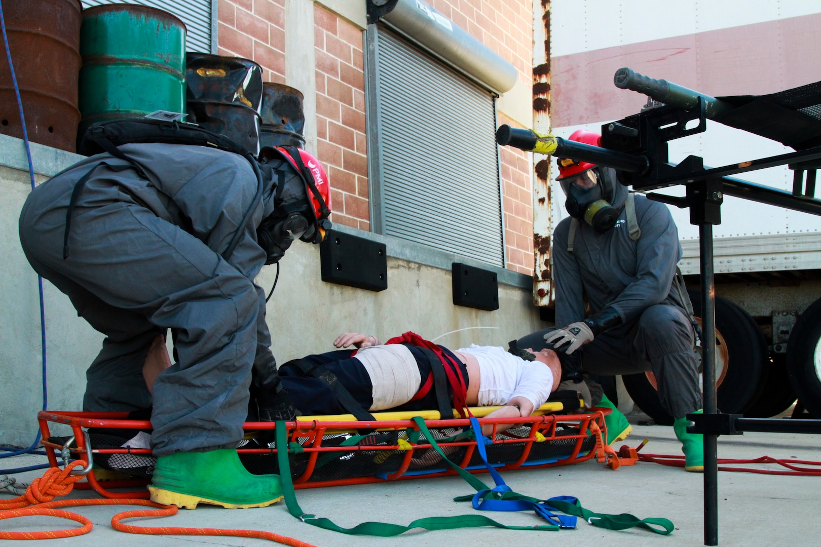 Spc. Robert Auman, 68th Engineer Construction Company horizontal engineer, and Spc. Malcolm Dent, 68th Engineer Construction Company vertical engineer, prepare a victim for transport to the medics during the Urban Search and Rescue lane at the San Antonio Fire Academy Nov. 5. This lane is part of a larger exercise run by U.S. Army North's Civil Support Training Activity, a unit comprised of teams that train with state and regional forces on a range of tiered chemical, biological, radiological and nuclear technical tasks that aid in the effective support of civil authorities during a response.