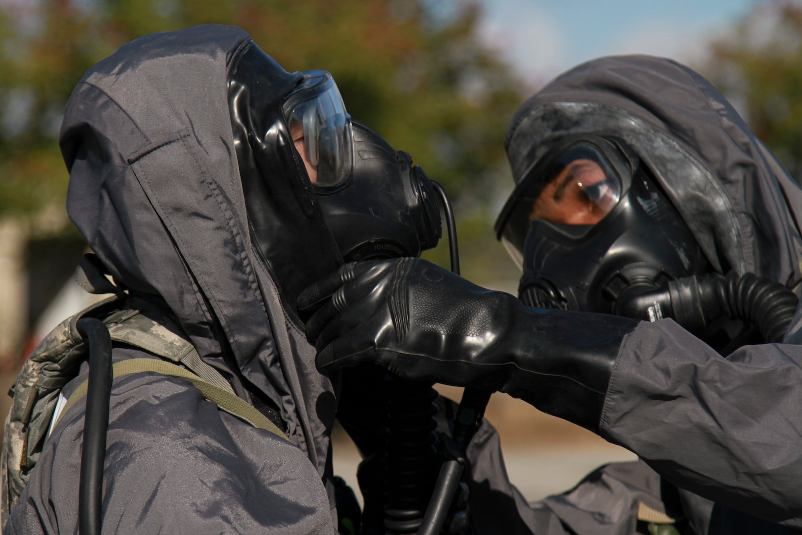Pfc. Jayson Morris-Dunlap (right), a signal support systems specialist, checks the mask of Pfc. Wenhui Huang (left), a chemical, biological, radiological and nuclear specialist, during a mass casualty decontamination lane at the Nelson W. Wolff Municipal Stadium Nov. 5. Both are assigned to the 181st Chemical, Biological, Radioactive and Nuclear Company.