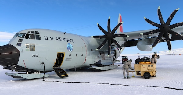 A member of the New York Air National Guard's 109th Airlift Wing performs maintenance on an LC-130, ski-equipped aircraft at McMurdo Station, Antarctica, on Dec. 17, 2018. The 109th normally provides logistics support to U.S. Antarctic research operations by flying people, equipment and supplies around the continent. Because of COVID-19, the wing will deploy aircraft to New Zealand this year where they will be on standby.