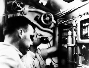 Lt. Cmdr. Dudley W. Morton is seen in the conning tower of USS Wahoo (SS-238) during an attack on an Imperial Japanese convoy north of New Guinea.