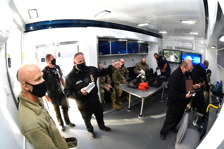 Fire fighters and others inside the MEOC trailer.