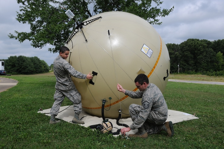 U.S. Air Force Airman 1st Class Coleton Barberree (left) and Master Sgt. Chad W. White, Radio Frequency Transmission specialists, 280th Combat Communications Squadron, Alabama Air National Guard, adjust a GATR (Ground Antenna Transmit and Receive) during the Hope of Martin Innovative Readiness Training (IRT) at Martin Middle School in Martin, Tenn., July 15.