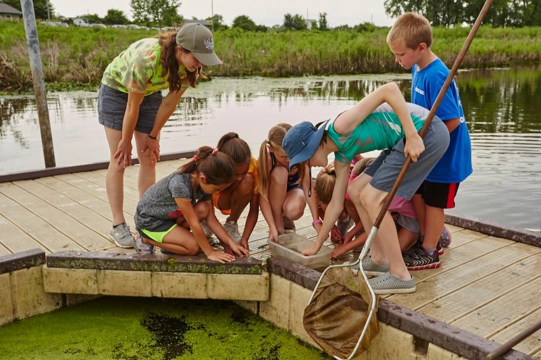 Kids exploring at Nahant Marsh