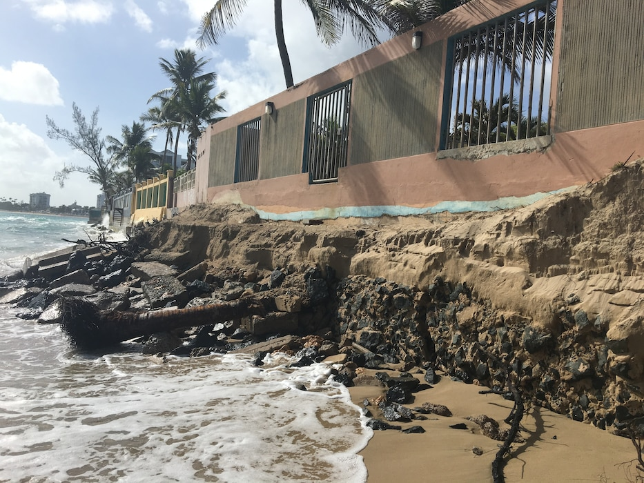 Beach sand with water and buildings in San Juan, Puerto Rico