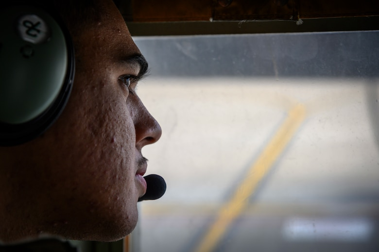 A U.S. Airman with the 1st Special Operations Squadron from Kadena Air Base, Japan, observes forward area refueling point (FARP) training from inside a U.S. Air Force MC-130J at Misawa Air Base, Japan, Nov. 18, 2020. When a fighter squadron has FARP support, options are vastly increased, as any accessible airfield or island can be used to replenish fighters and send them back to the fight. (U.S. Air Force photo by Airman 1st Class China M. Shock)