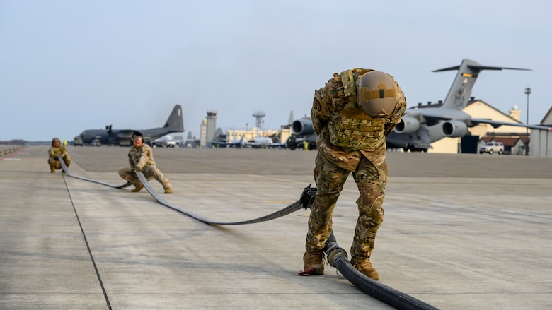 A U.S. Airman with the 1st Special Operations Squadron from Kadena Air Base, Japan, drains the gas from a fuel hose during a forward area refueling point (FARP) training at Misawa Air Base, Japan, Nov. 18, 2020. FARP, a specialty within the petroleum, oils and lubrication career field, trains Airmen to effectively refuel aircraft in remote locations when air-to-air refueling is not possible or when fueling stations are not accessible. (U.S. Air Force photo by Airman 1st Class China M. Shock)