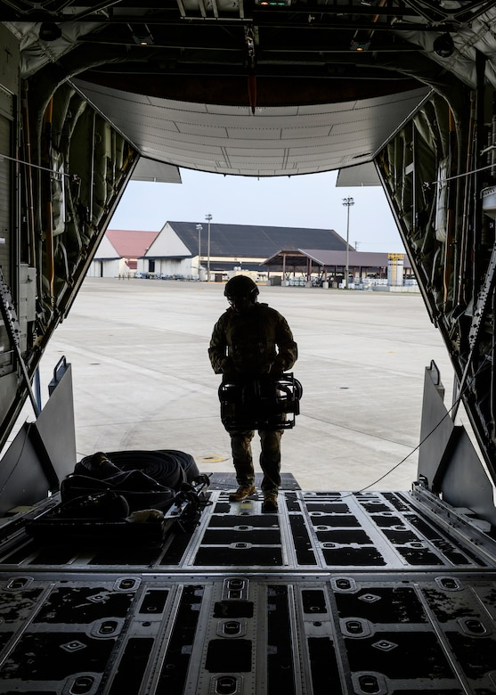 A U.S. Airman with the 1st Special Operations Squadron from Kadena Air Base, Japan, puts equipment away during a forward area refueling point training at Misawa Air Base, Japan, Nov. 18, 2020. This concept allows fighter aircraft to land, replenish fuel or rearm before returning to air-battle operations within a short period of time in harsh territories. (U.S. Air Force photo by Airman 1st Class China M. Shock)